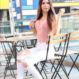 Vibrant white distressed jeans